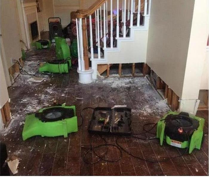 Our equipment being used to dry the wood floor of a home