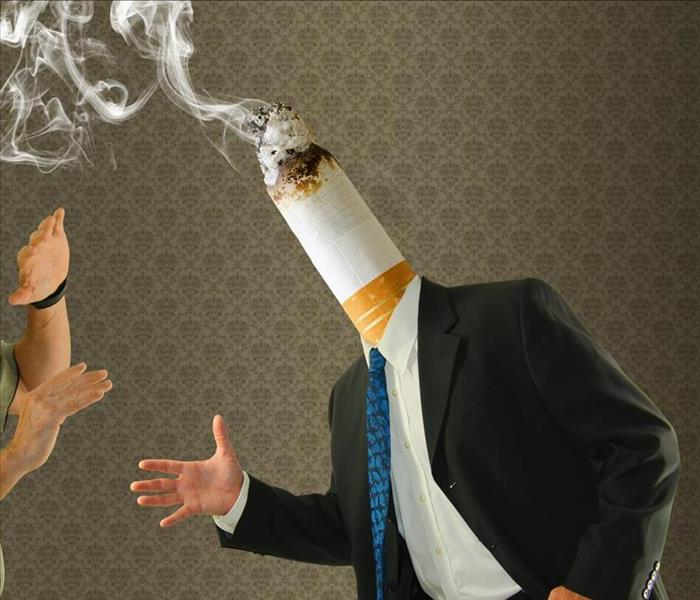 A cigarette butt instead of a human head of a man wearing a suit